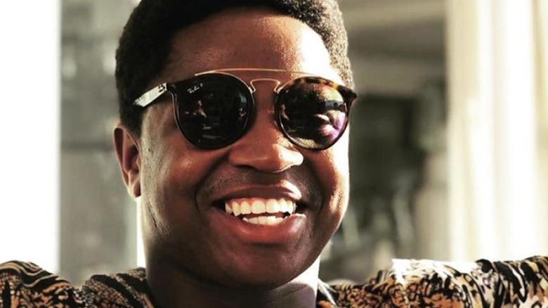 Mzi 'Zee' Dempers, wearing sunglasses, smiling, 2019 photo