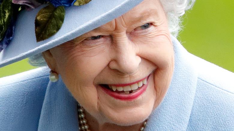 Queen Elizabeth II smiles for the camera in 2019