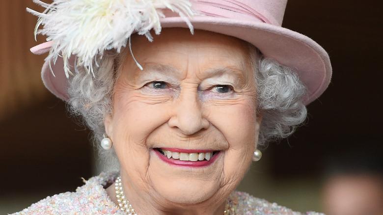 Queen Elizabeth, smiling, wearing a hat, 2017 photo