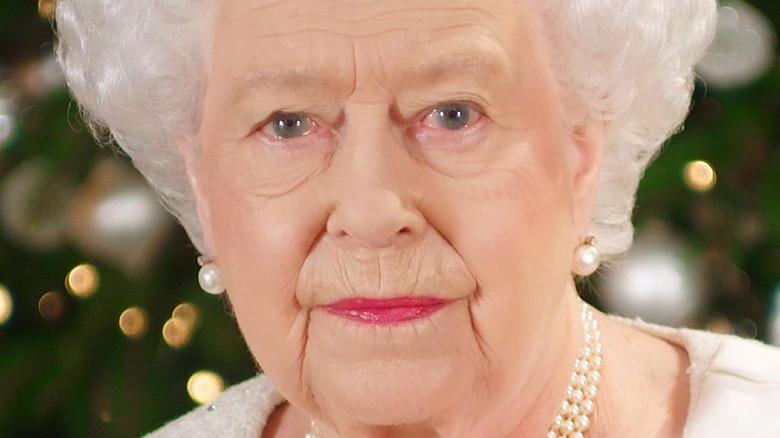 Queen Elizabeth purses her lips during a photo call