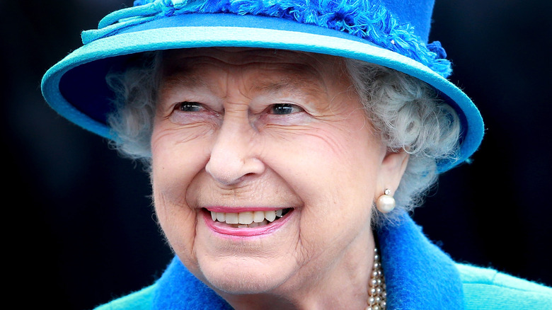 Queen Elizabeth, 2015 photo, smiling and wearing a hat