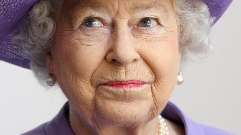 Queen Elizabeth looking to the side with slight smirk