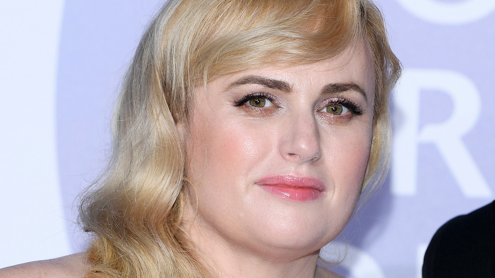 Rebel Wilson looking serious on the red carpet