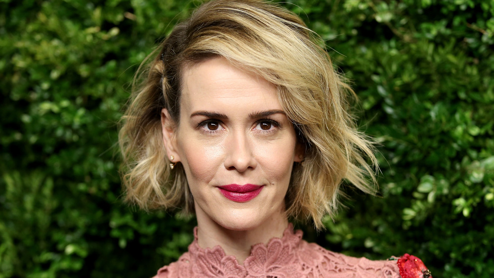 Sarah Paulson with short hair, dressed up, slightly smiling at a 2020 Vanity Fair party for the Oscars