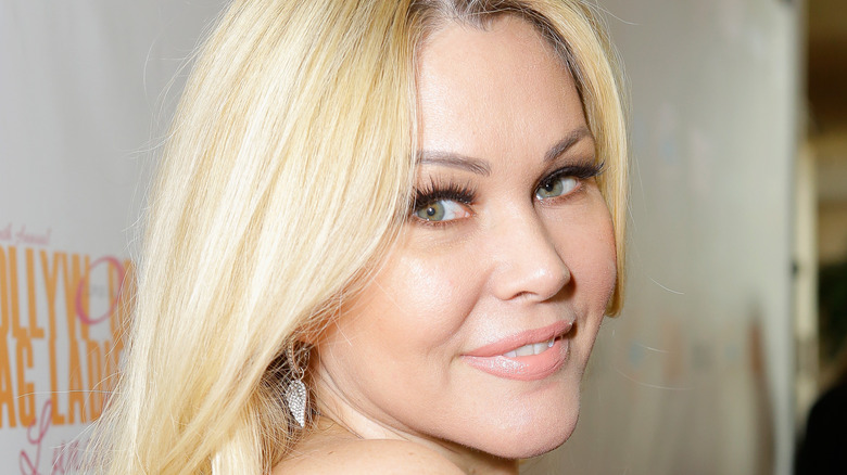 Shanna Moakler smiling at a red carpet event