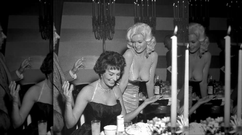 Sophia Loren and Jayne Mansfield at a party thrown by Paramount Studios for Loren in 1957