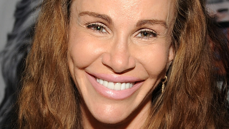 Tawny Kitaen smiles at an event