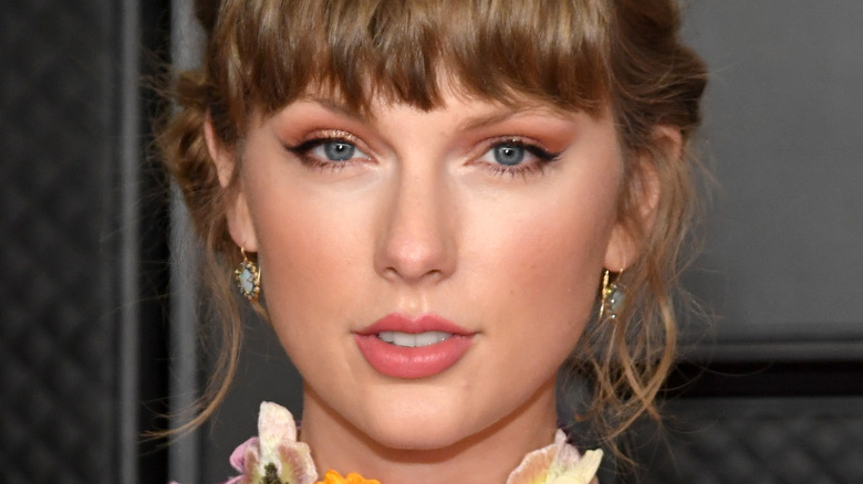 Taylor Swift looks at camera