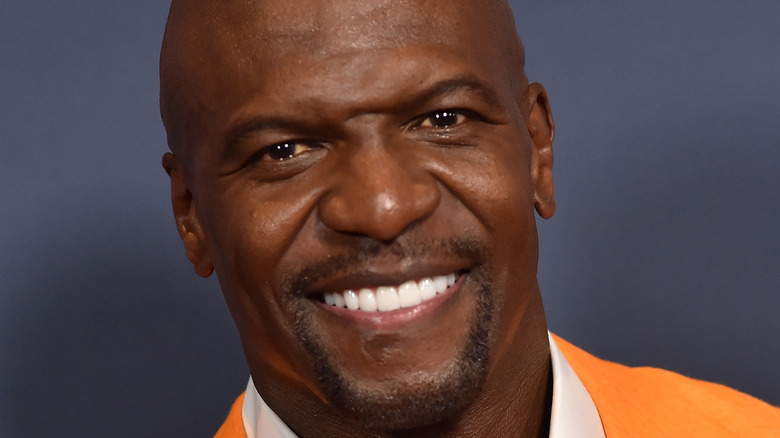 Terry Crews flashes a big smile at NBC upfronts