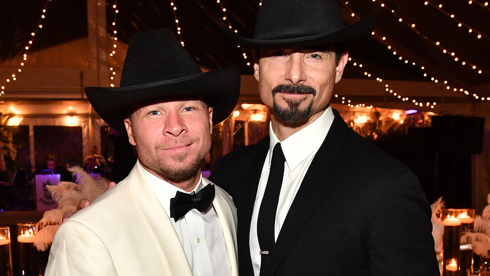 Brian Littrell and Kevin Richardson pose together in black cowboy hats