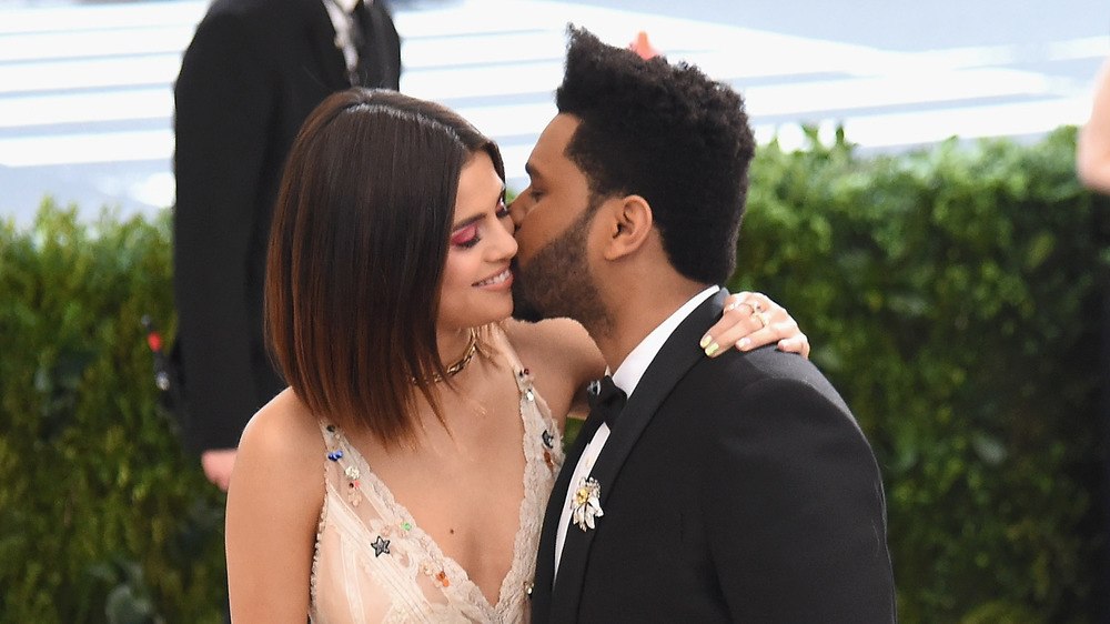 Selena Gomez and The Weeknd posing