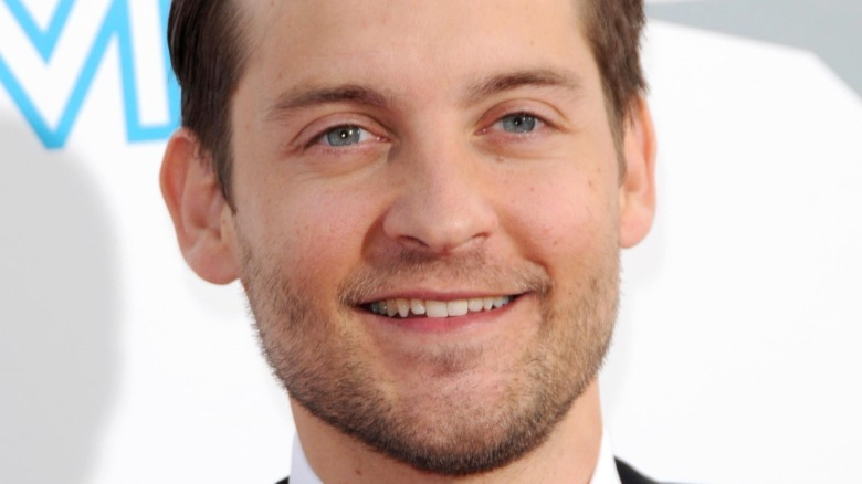 Tobey Maguire, smiling, 2009 photo, no facial hair, red carpet