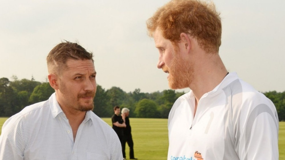 Tom Hardy and Prince Harry talking