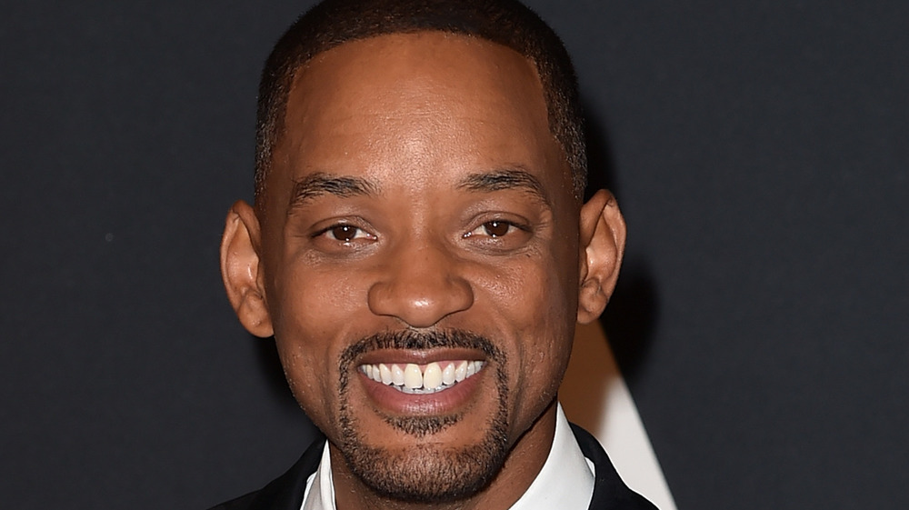 Will Smith smiling on red carpet