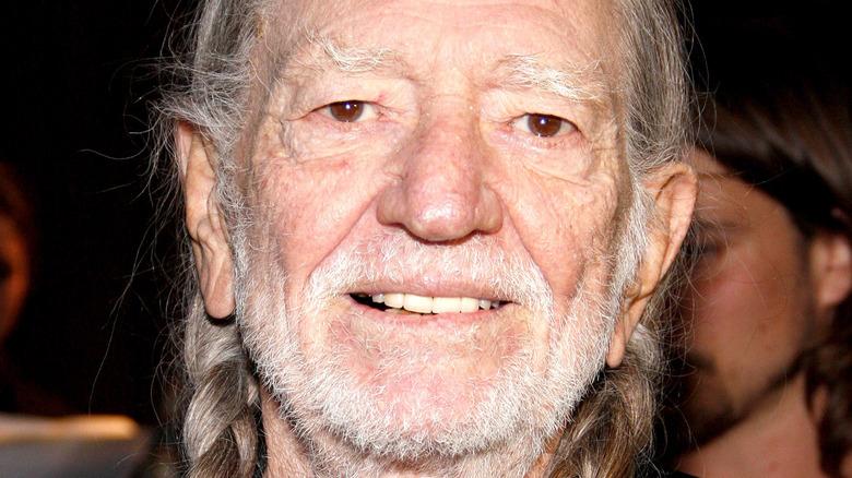 Willie Nelson posing