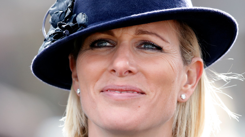 Zara Tindall gives a small smile at a public engagement