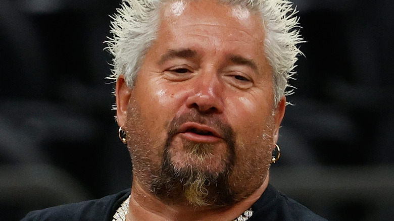 Guy Fieri speaking and looking to the side