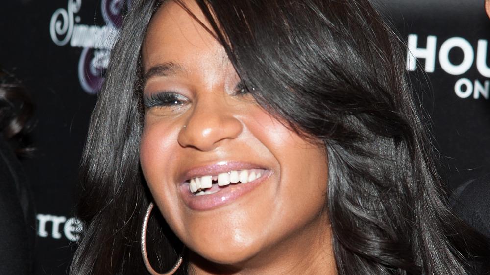 Bobbi Kristina Brown smiling on the red carpet