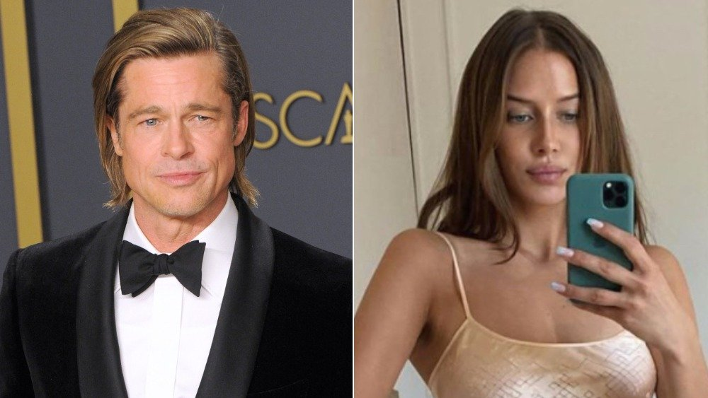 Brad Pitt poses with his Oscar, Nicole Poturalski