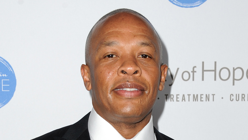 Dr. Dre smiles at an event