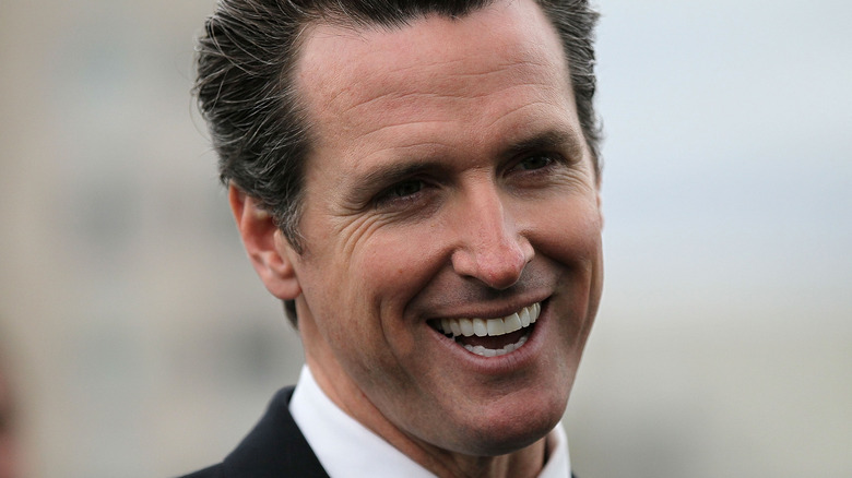 Gavin Newsom smiling at an event