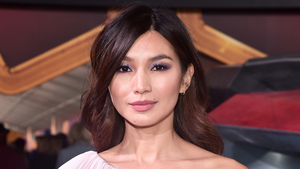 Gemma Chan posing on the red carpet at the Captain Marvel premiere