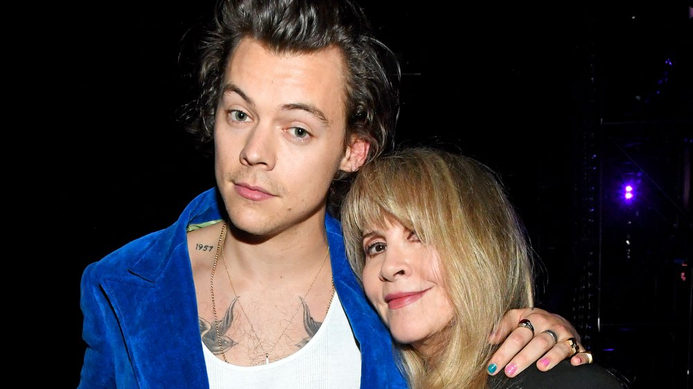 Harry Styles and Stevie Nicks posing arm in arm