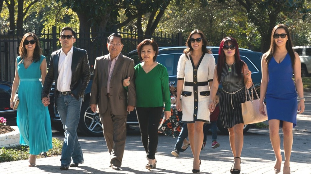 Members of the Ho family walking down the street