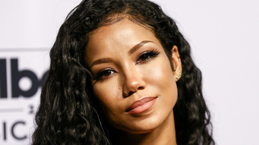 Jhene Aiko posing at step and repeat
