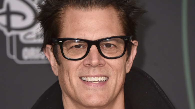 Johnny Knoxville in a black coat