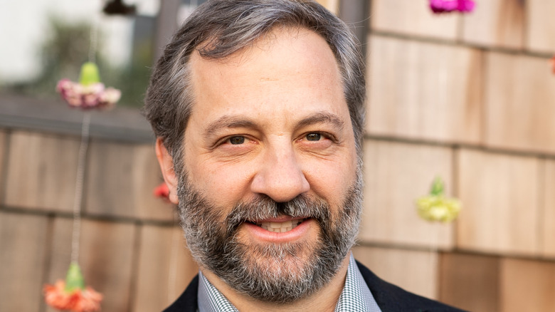 Judd Apatow in front of flowers