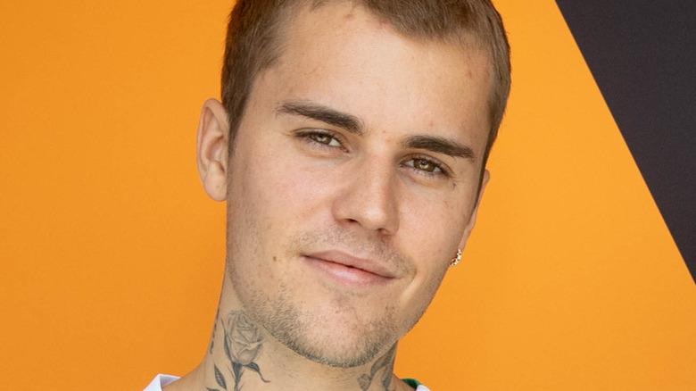 Justin Bieber smiles at camera