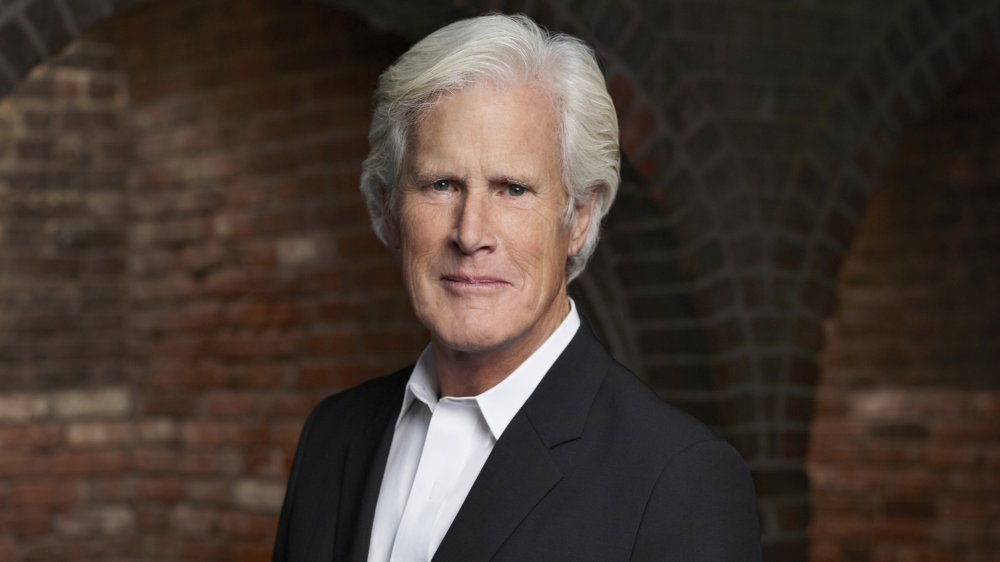 Keith Morrison in a black blazer and white button-up, posing with a neutral expression
