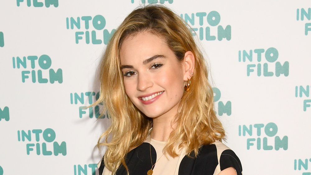Lily James smiling while tilting her head to the side