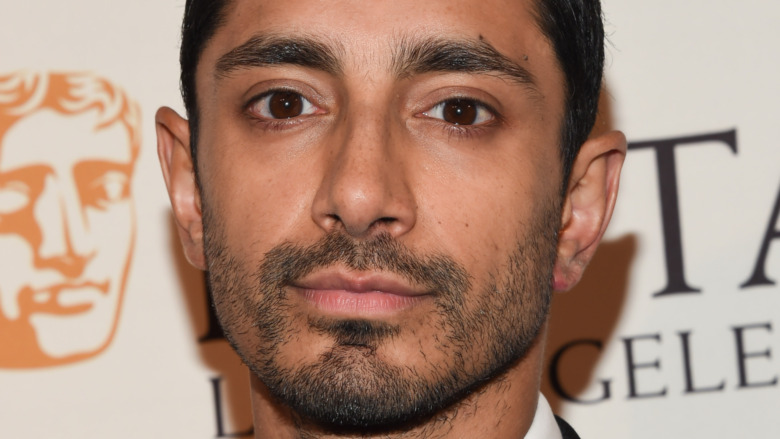 Riz Ahmed with a serious expression