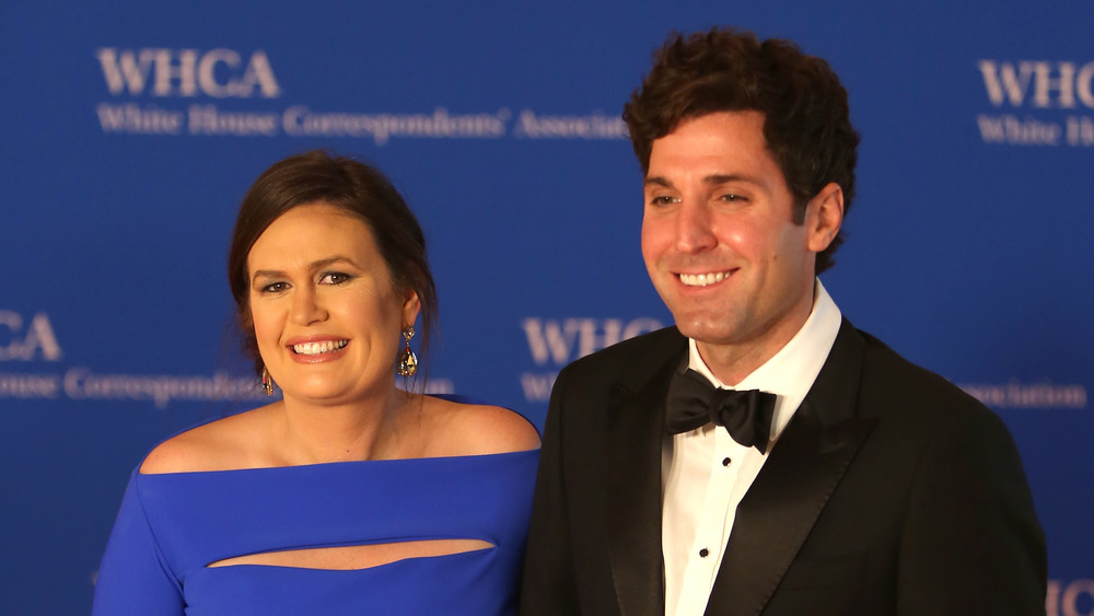 Sarah Huckabee Sanders at a red carpet event with husband Bryan Sanders