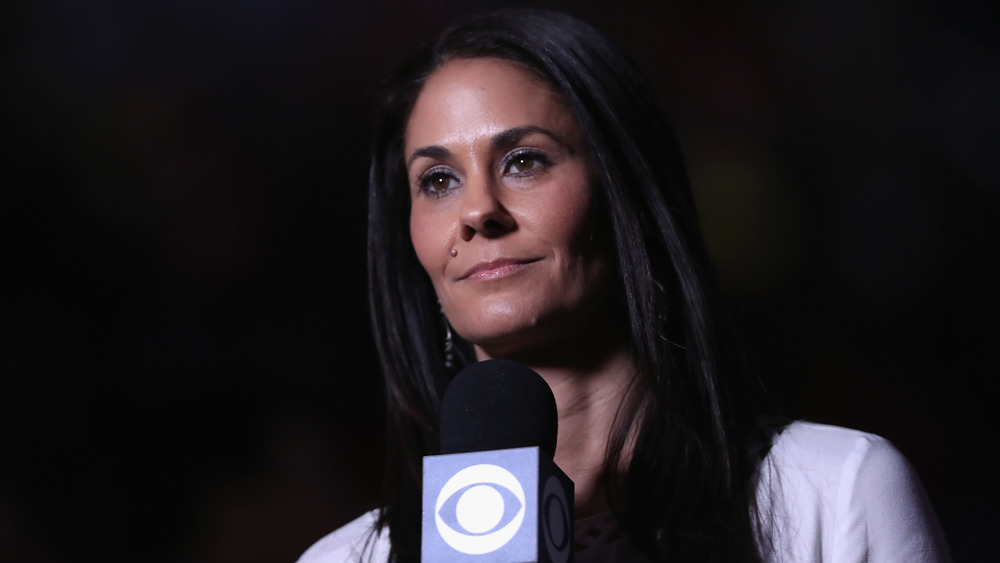 Tracy Wolfson holds a microphone