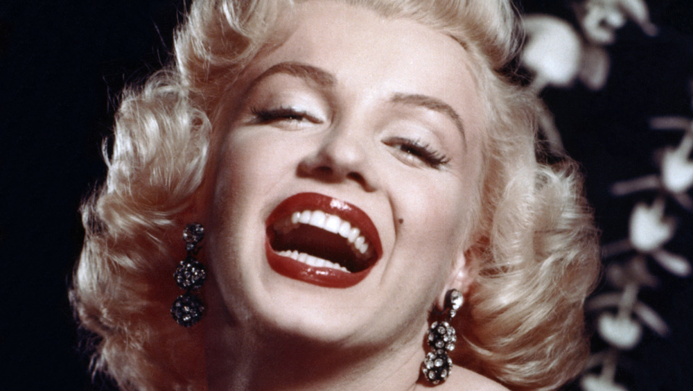 Marilyn Monroe smiling with mouth open