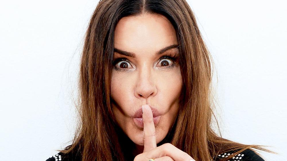"""Janice Dickinson """"shh"""" pose"""