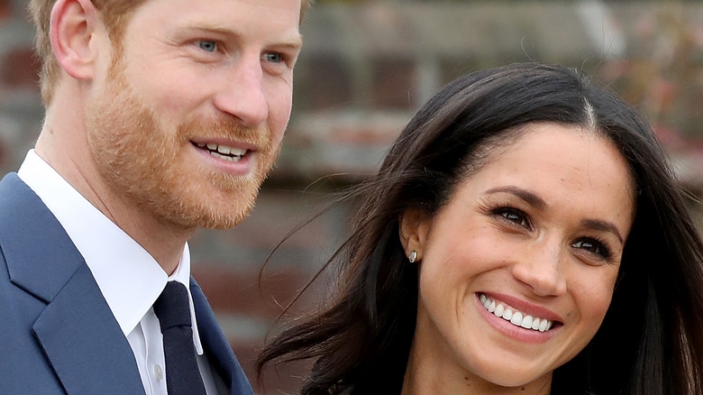 Prince Harry and Meghan Markle leaning in
