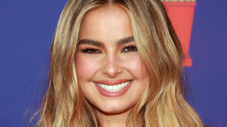 Addison Rae, smiling, wearing blond hair down, 2021 MTV red carpet