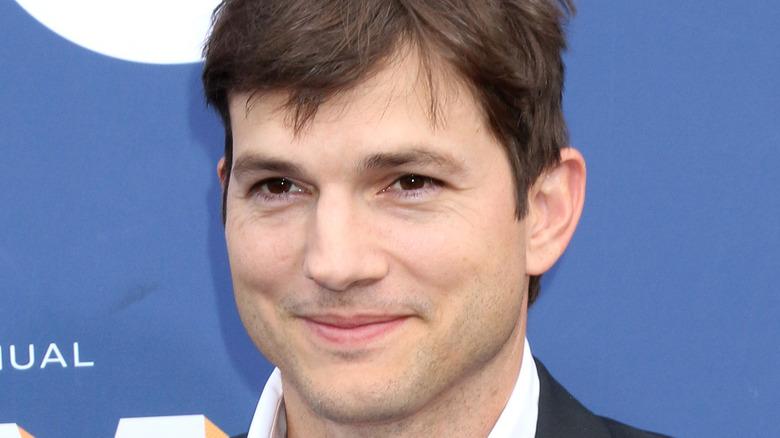 Ashton Kutcher smiles on the red carpet