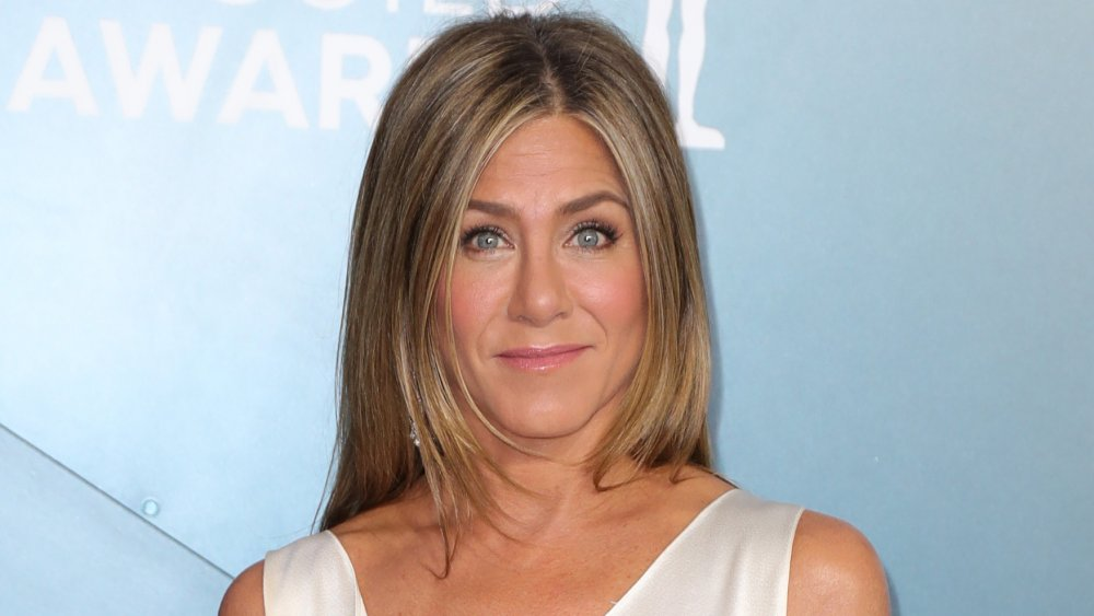 Jennifer Aniston at the 2020 SAG Awards, posing with a small smile