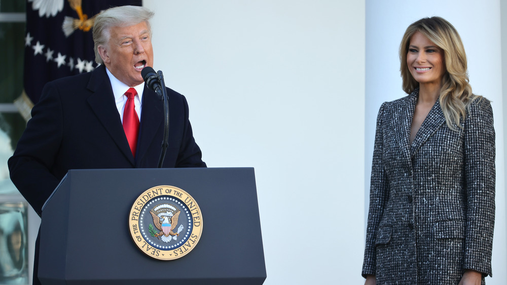 Melania Trump standing by Donald Trump's side during a speech
