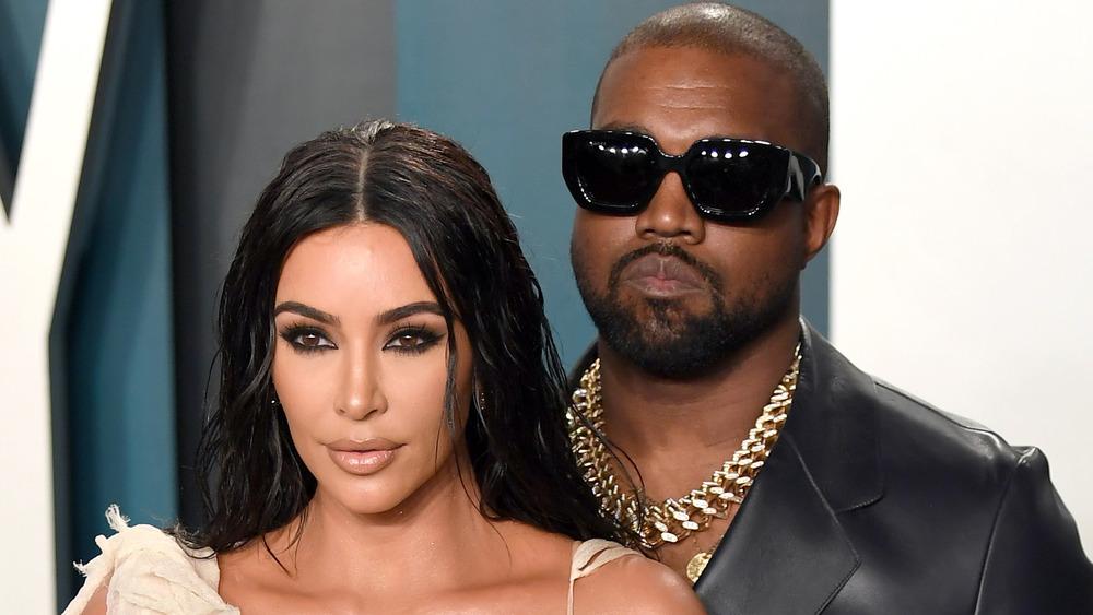 Kim Kardashian West and Kanye West posing for cameras