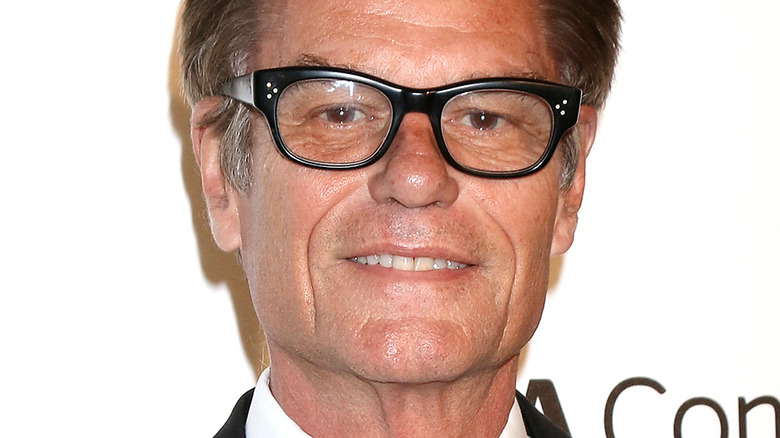 Harry Hamlin smiling in glasses at an event