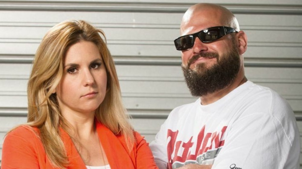 Brandi Passante looking tough alongside Jarrod Schulz smiling in a promotional shot for A&E's Storage Wars