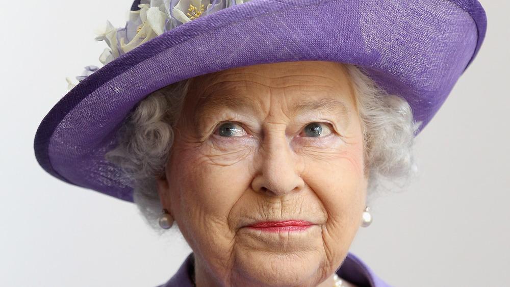 Queen Elizabeth posing in a hat
