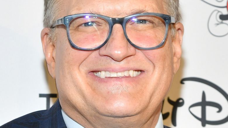 Drew Carey smiling on the red carpet