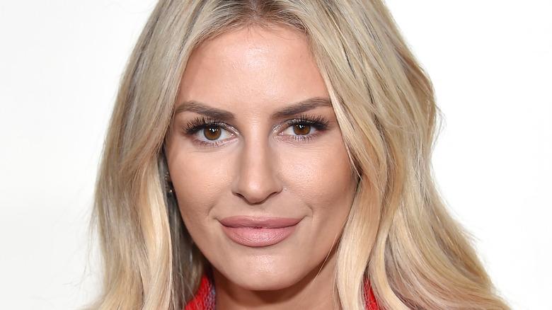 Morgan Stewart, smirking, 2019 award show red carpet, wearing makeup, blond hair down